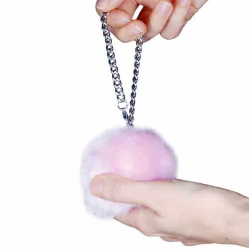 Fur Ball Buzzer Personal Alarm Pink Held in Hands